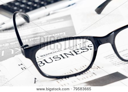 Business Word See Through Glasses Lens On Financial Newspaper