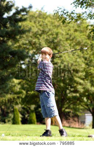 Boy Smiling Playing Golf