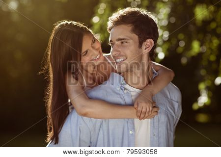 Young Couple Holding Eachother In A Park