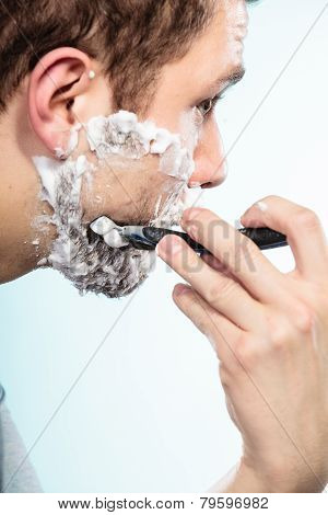 Man Shaving With Razor Face Profile