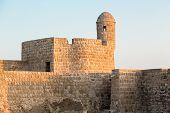 stock photo of bahrain  - Dusk at the recontructed Bahrain Fort near Manama at Seef Bahrain - JPG