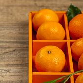 stock photo of clementine-orange  - Tangerines or Mandarin orange in the orange box - JPG