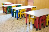 stock photo of bench  - kindergarten with small benches and small colored chairs - JPG