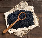 image of cumin  - Nigella sativa or Black cumin with a spoon in wood - JPG