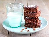 foto of milk glass  - Chewy chocolate and coconut slice and milk in glass - JPG