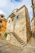 stock photo of old stone fence  - The old stone house in Supetar town center - JPG