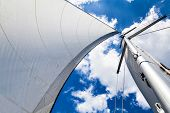 pic of mast  - Mast and sail against the sky with clouds on a sunny day - JPG