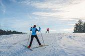 foto of ascending  - Cross country skier ascending a steep slope - JPG