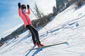 foto of nordic skiing  - Woman cross country skiing on a yellow skis - JPG