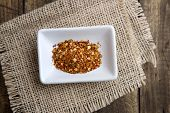 picture of cayenne pepper  - ground cayenne pepper in bowl on wooden surface - JPG