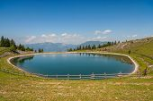 stock photo of accumulative  - Accumulation lake on beautiful Golte hill - JPG