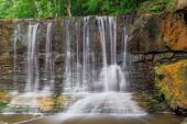 foto of flow  - A small section of Anderson Falls near Columbus Indiana is seen here with a light flow in the middle of summer - JPG