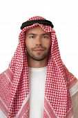 stock photo of headdress  - Friendly man in Arabic headdress - JPG
