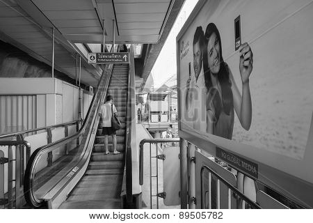 Travellers Pass Through A Bts Skytrain Station