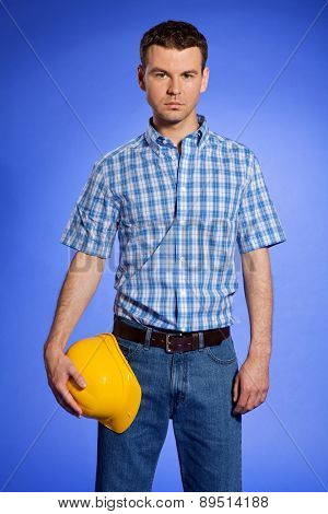 Portrait of architect holding hardhat