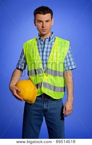 Portrait of architect in coveralls holding hardhat