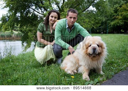 Portrait of young couple with dog