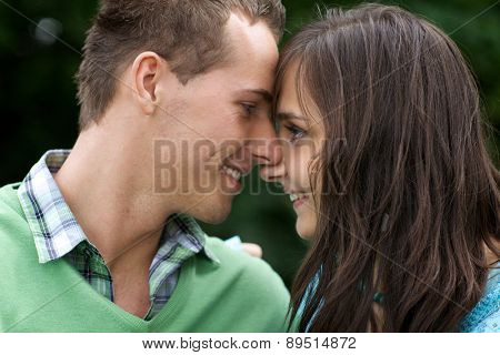 Close-up of young couple looking at each other