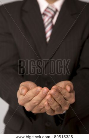 Young caucasian businessman with cupped hands