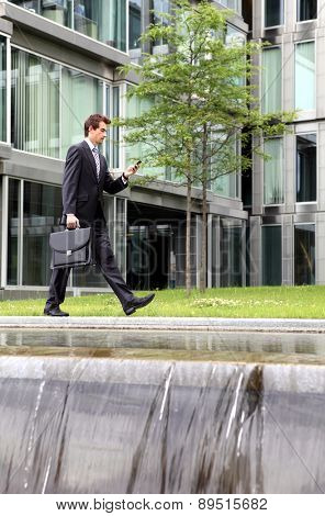 portrait of young confident caucasian businessman talking on cellphone