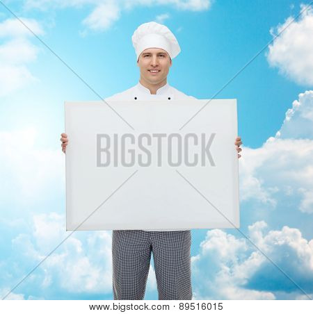 cooking, profession, advertisement and people concept - happy male chef cook holding and showing white blank big board over blue sky with clouds background