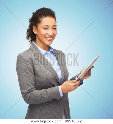 business, education, people and technology concept - smiling african american woman holding tablet pc computer over blue background