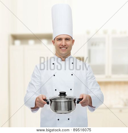 cooking, profession and people concept - happy male chef cook holding pot