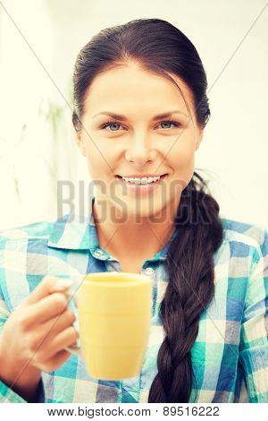 bright picture of lovely housewife with mug