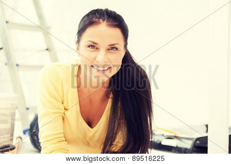 bright picture of lovely housewife making repairing works