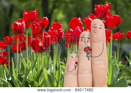 Conceptual Family Finger Art. Father And Son Are Giving Flowers  His Mother. Stock Image