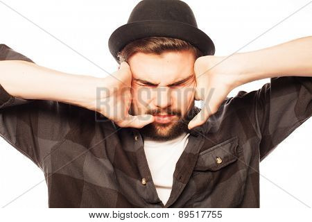 Young man with squares shirt covering his ears with his hands. Isolated on white.
