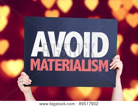 Avoid Materialism card with heart bokeh background