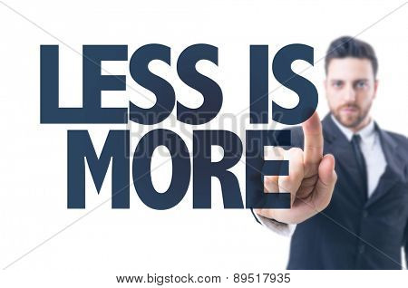 Business man pointing the text: Less is More