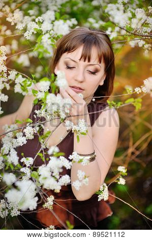 Beautiful Woman In Spring Cherry Garden