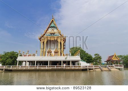 Temple with canal and sky background