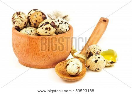 Quail Eggs With Feather In A Wooden Bowl And Spoon