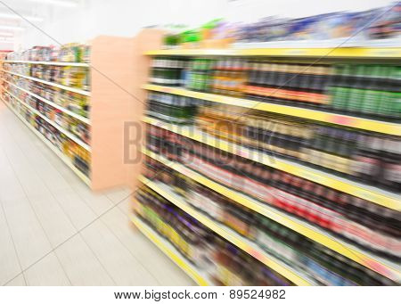 Shelves With Beverages Bottles In Grocery Food Store In Supermarket
