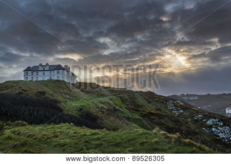 Liskeard, United Kingdom, 12 April 2015. A photo taken at sunrise of the Mullion Cove Hotel at Mulli