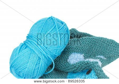 Knitting Yarn And Piece Of Sweater Isolated