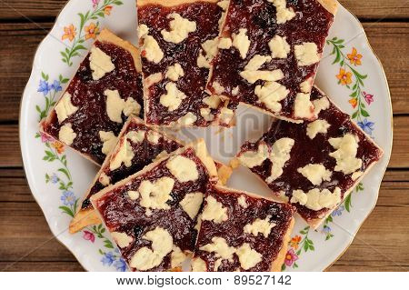 Berry Jam Cookies In White Plate On Wooden Background Topview