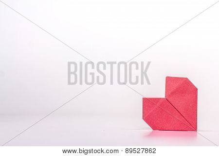 Photo of red origami heart isolated on white background