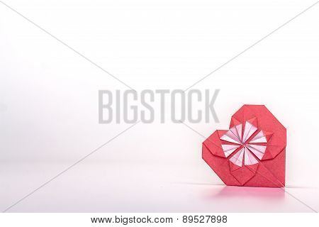 Photo of red paper heart isolated on white background