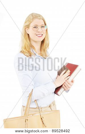 Beautiful blond female holding books