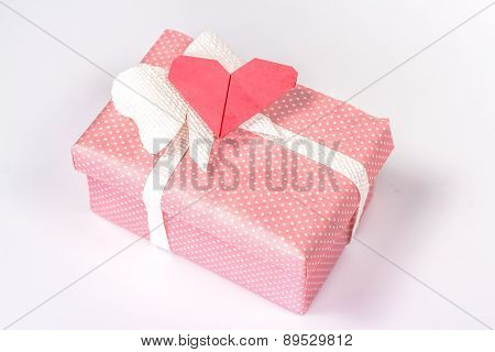pink gift box with origami paper heart and blank card.