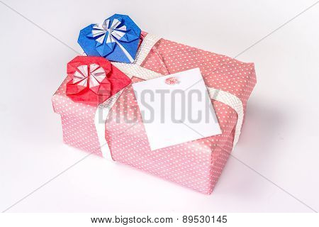 gift box with blank card and two paper hearts - red and blue
