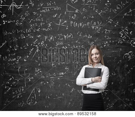 Beautiful Blonde Business Woman Is Holding A Black Document Case. Drawn Mathematics Equations And Fo