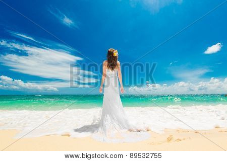 Happy Beautiful Fiancee In White Wedding Dress Standing With His Back To The Viewer On Shore Sea.