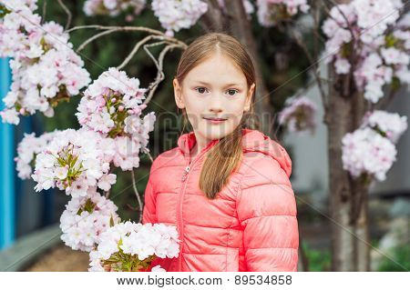 Spring portrait of a pretty little girl of 7 years old