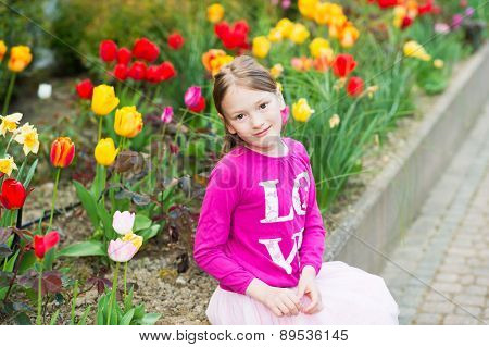 Outdoor portrait of a cute little girl of 7 years old