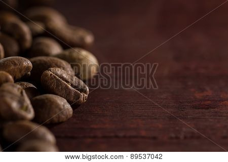 Coffee Beans On Wooden Table, Ready To Brew Delicious Coffee